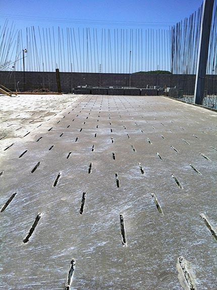 Top, concrete layer of ventilated flooring.